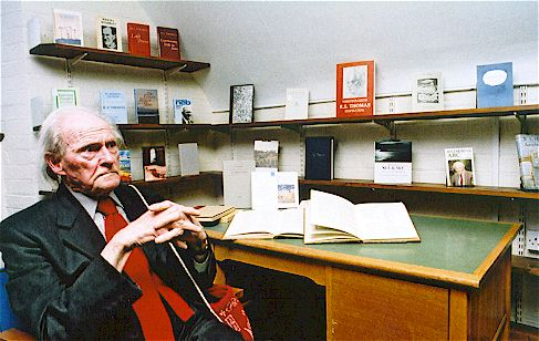 Poet R. S. Thomas pictured at the centre surrounded by a number of his published works